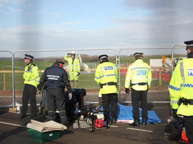 Police removing locked-on protesters at the Preston New Road fracking site at the height of the protests before a halt on fracking was announced by the Government in November 2019