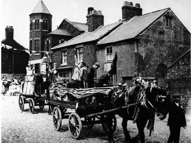 Poulton Whit Walk in the early 1900s passing the old Methodist Chapel on the corner of Chapel Street. The cottages still remain, but the chapel was demolished in 1964 after 150 years of Methodism in the town.