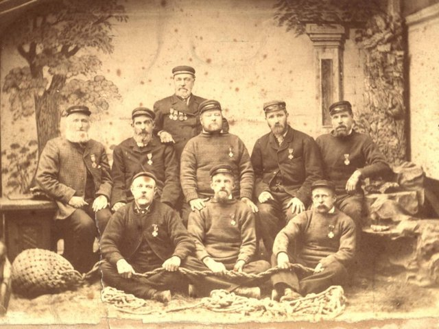 The Blackpool Lifeboat Crew of 1880 with bearded Richard Parr (far left middle row). They were the  crew of the first blackpool lifeboat, Robert William