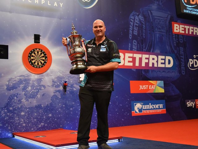 2019 World Matchplay champion Rob Cross with the Phil Taylor Trophy at Blackpool's Winter Gardens
