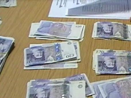Some of the cash previously seized from a loan shark in Chorley