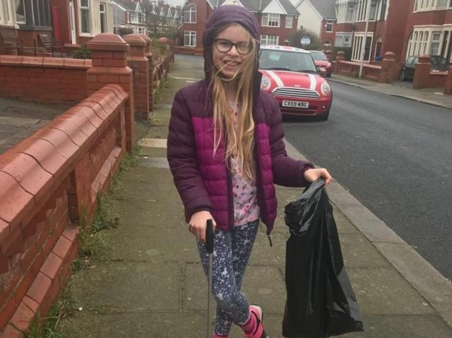 Amelia Brookes doing her bit for the community by  litter picking