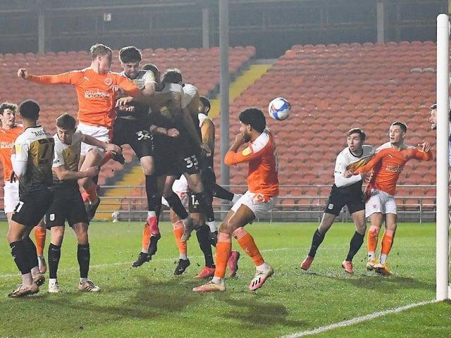 Dan Ballard rises highest to head home his first Blackpool goal