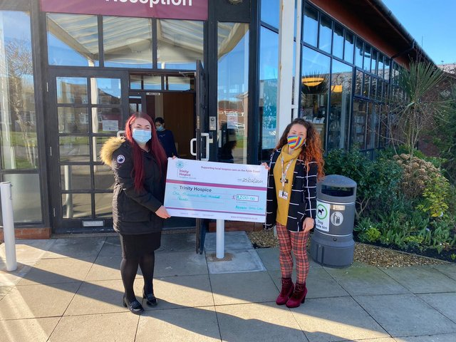 Hayley Bielby, from Alexander Grace Law, presenting a cheque to Lauren Codling, from Trinity Hospice, following Wills Week