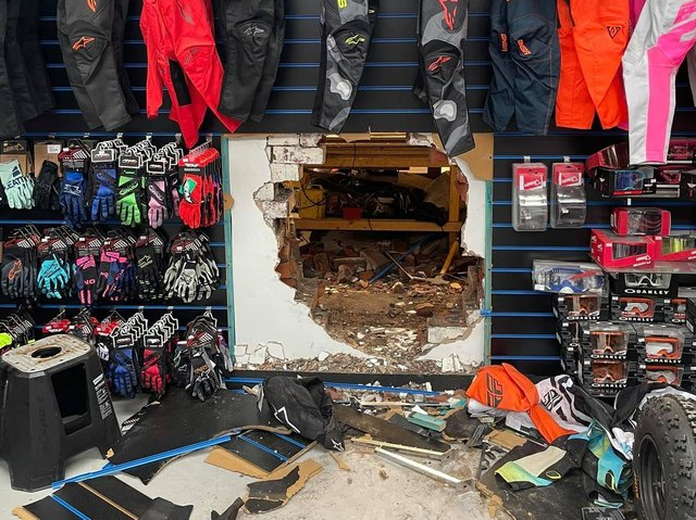 Four bikes - worth thousands - were fed through the hole by the thieves who smashed through three layers of brick to gain entry