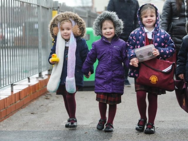 Pupils at Roseacre Primary Academy return to school as coronavirus lockdown restrictions begin to lift.  L-R Friends Gracie-Mae Green, Meredith Evans and Lilly Weddle make their way to class.
