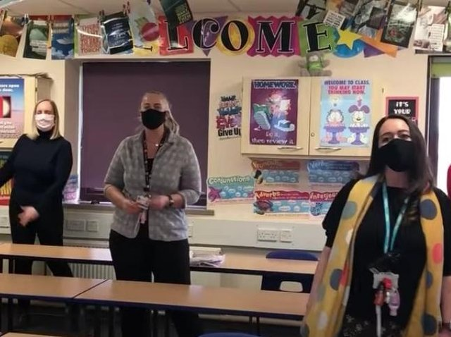 Staff at Montgomery Academy welcomed back their pupils 'for good' with a remake of classic 90s boy band single Back for Good, by Take That. Pic: FCAT Youtube