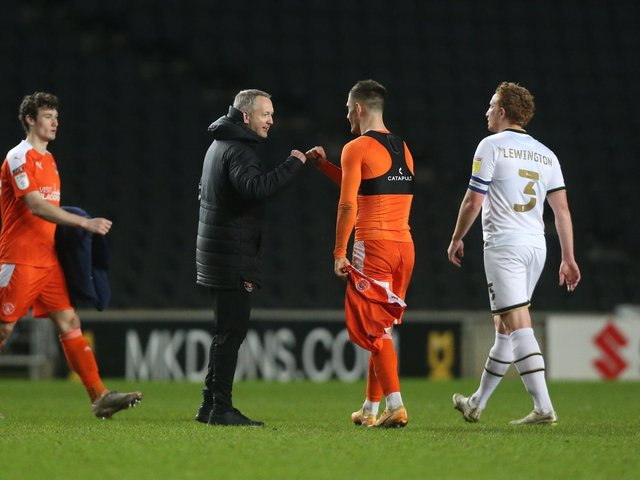 Neil Critchley congratulates Jerry Yates after his midweek winner at MK Dons