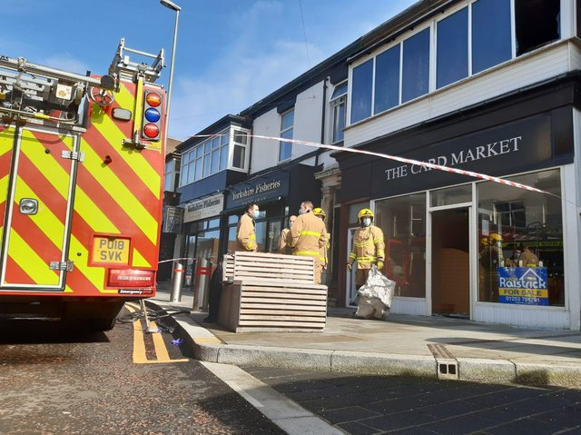 The person was lifted to safety from the first floor window of the Topping Street flat, above the formerCard Market shop, at 7.37am