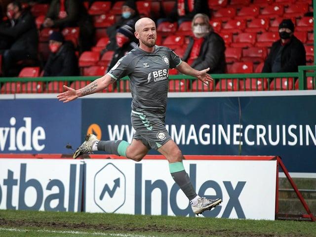 Madden celebrates scoring against Swindon Town.