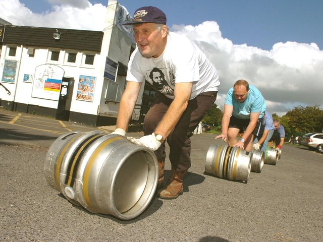 Preparations for Lytham Beer Festival at Lowther Pavillion, 2009. Ray Jackson and CAMRA colleagues roll out the barrells.
