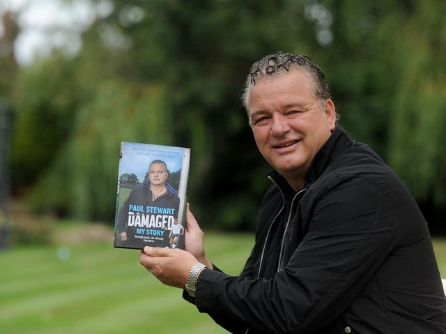 Paul Stewart with his autobiography Damaged in 2019