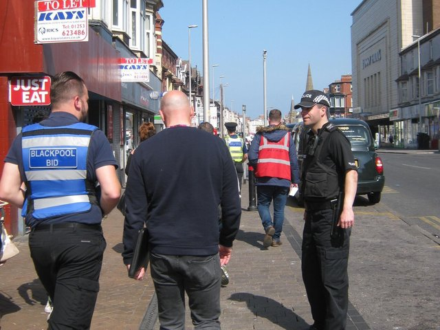 The Blackpool BID team out with police officers to keep the streets of the town centre looking better for visitors