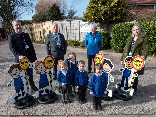 Some of the children with Coun Paul Wilshaw, John Topping from FCAT, Coun Don Clapham and headteacher Amanda Stokes