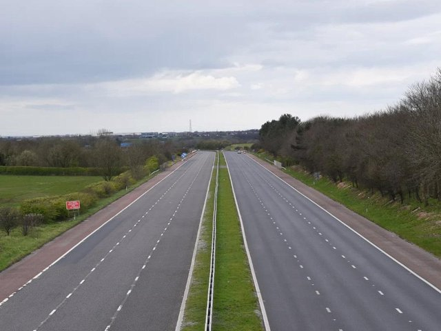 The M55 motorway, looking towards Blackpool, empty on a Saturday midday due to the coronavirus social distancing measures