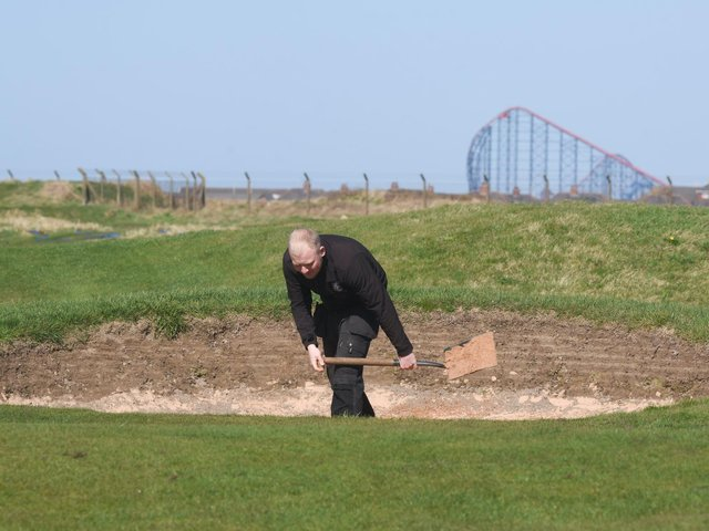 The course being prepared at St Annes Old Links golf club, with its backdrop of Blackpool's The Big One