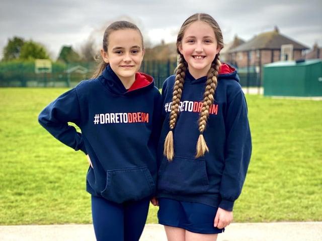 Flakefleet pupils Brooke Parker (left) and Maicey Swales model the new school unform