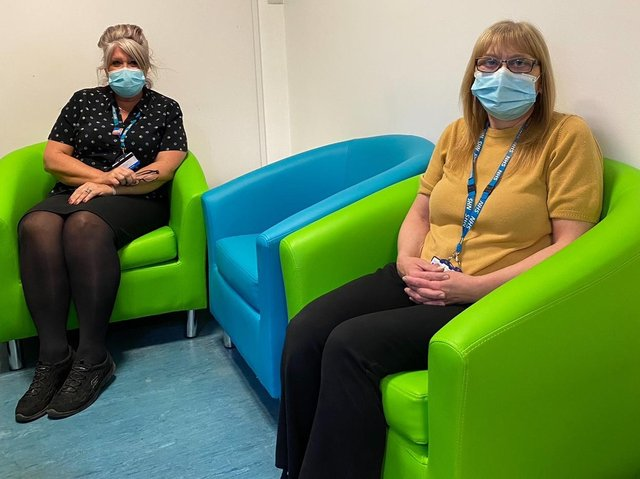 Medical Records department staff Julie Bonell (left) and Gail McBride enjoy their new seating. Photo: Blue Skies