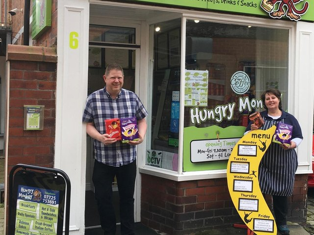 Amanda Hill, from Hungry Monkey sandwich shop on Back St Annes Road West, St Annes, and  Marc Bennett with Easter eggs for Home-Start