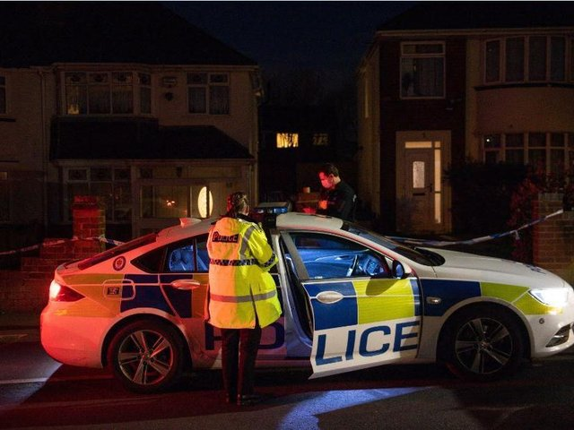 Police at the scene in Rowley Regis, West Midlands where a woman in her 80s died after being attacked by two escaped dogs