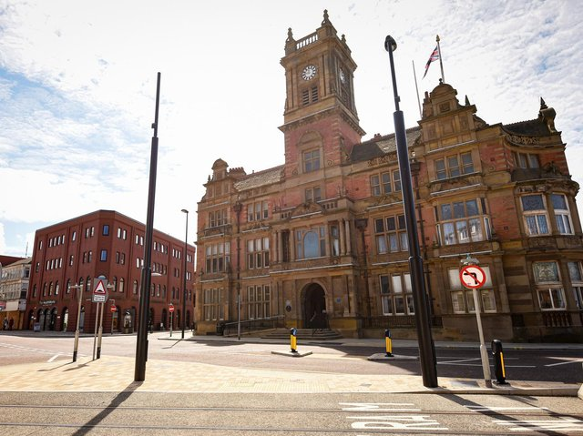 Town hall pay is under scrutiny