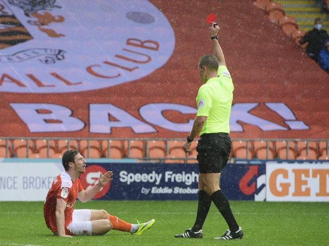James Husband was sent off during the game with Lincoln City at Bloomfield Road