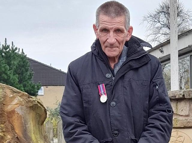 Frank Bryszkiewski wearing his father's medal at the memorial in Longridge