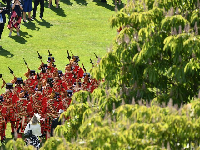 Yeomen of the Guard are seen at a garden party in the grounds of Buckingham Palace in central London on May 21, 2019