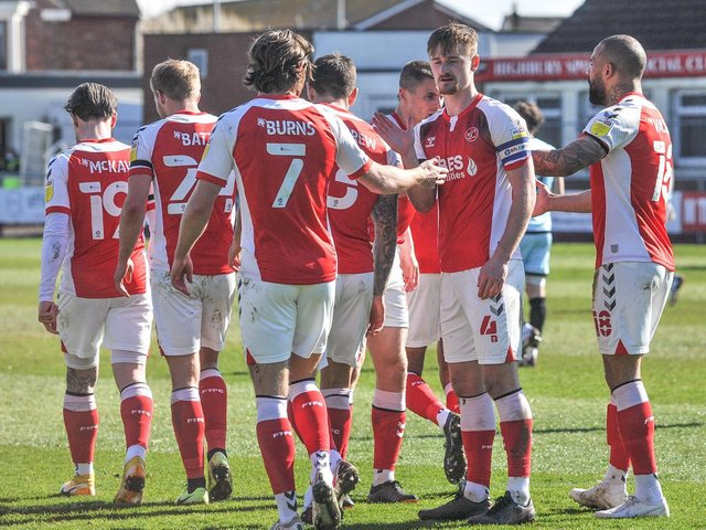 Wes Burns is congratulated for his contribution to Fleetwood Town's winner Picture: Stephen Buckley/PRIME Media Images Limited