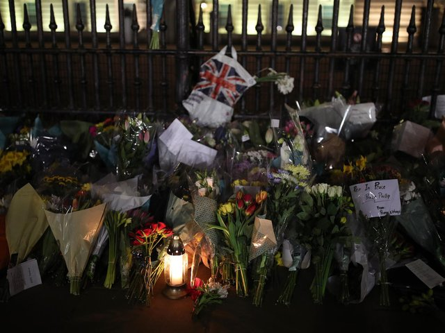 Floral tributes and candles are left outside Buckingham Palace, London, following the announcement of the death of the Duke of Edinburgh at the age of 99. Picture date: Friday April 9, 2021. Picture: PA Wire/PA Images/Yui Mok