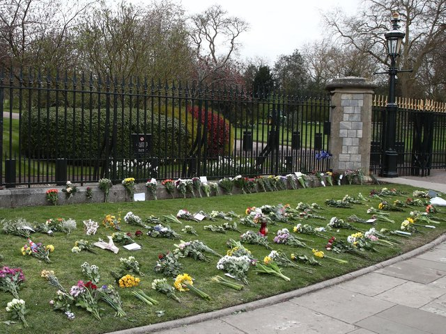 Flowers left by Cambridge Gate at Windsor Castle, Berkshire, following the announcement of the death of the Duke of Edinburgh at the age of 99. Picture date: Saturday April 10, 2021. Picture: Gareth Fuller/PA Wire/PA Images