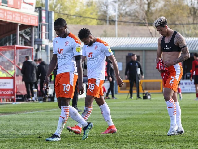 Blackpool's players let a two-goal lead slip at Lincoln City on Saturday