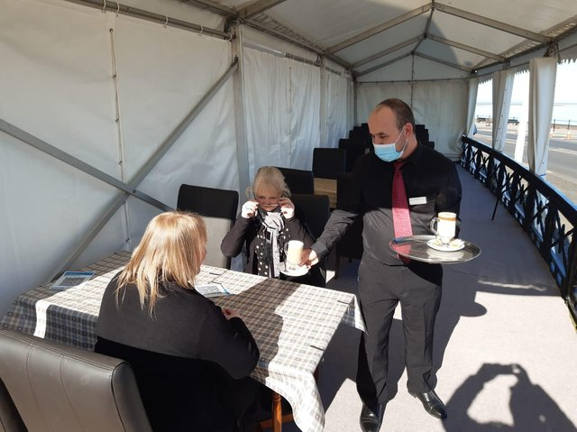 Coffee is served in the marquee at the front of Fleetwood's North Euston Hotel