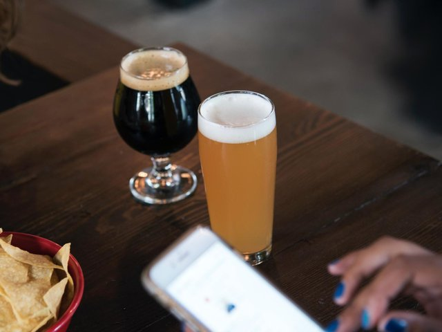 Older drinkers without smartphones at risk of discrimination in pubs