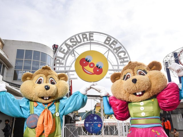 Mr Funshine is back for the 125th season of Blackpool Pleasure Beach.  Pictured are Bradley and Bella Beaver.