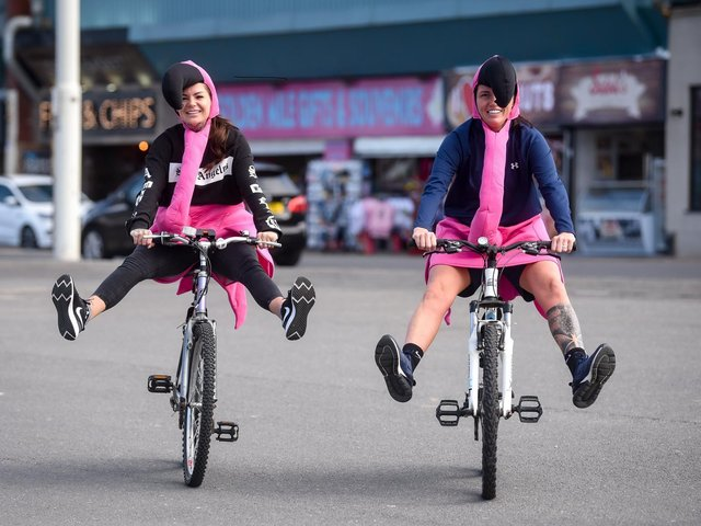 Stefi Jefferson and Jodie Reynolds are cycling dressed as pink flamingos to raise money for Stefi's sister Michelle.
