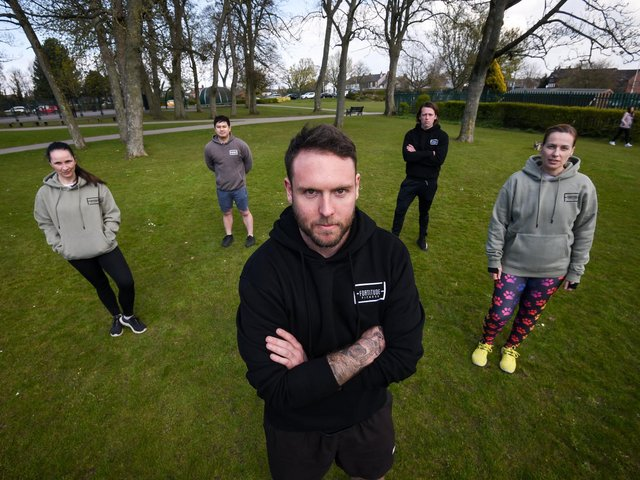 Personal trainers at Fortitude Fitness in Poulton were angry with the new outdoor fitness permit scheme introduced by Wyre Council. The new scheme means PTs and fitness instructors must now apply for a permit to train clients outdoors on council land or the beach. Left to right: Personal trainers Claire Nutton, Benjamin Li, Fortitude Fitness co-owner Mikey Moon, Toby Parker and Eleanor Silcock. Photo: Daniel Martino for JPI Media