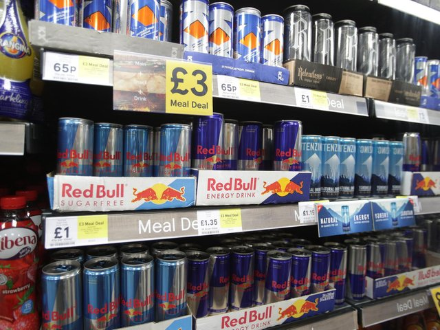 Shelves of energy drinks on sale.
