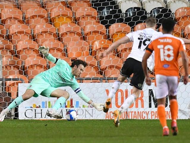 Blackpool keeper Chris Maxwell makes his midweek penalty save