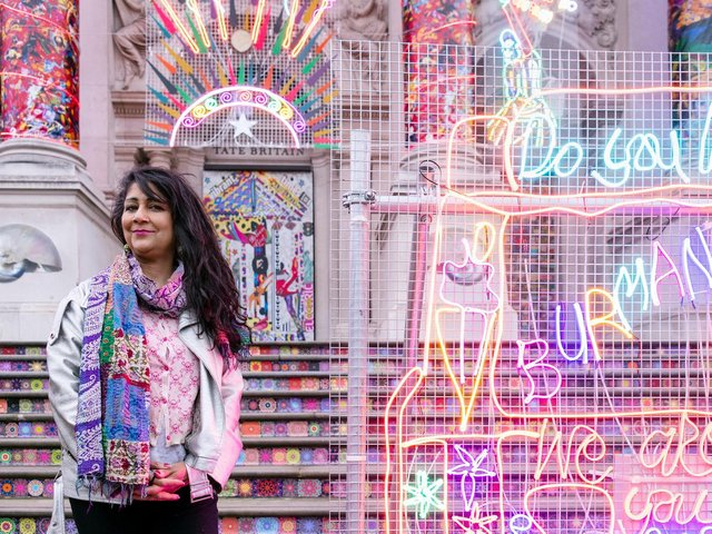 Chila Kumari Burman with her work for the Winter Commission at the Tate Phot by Joe Humphrys