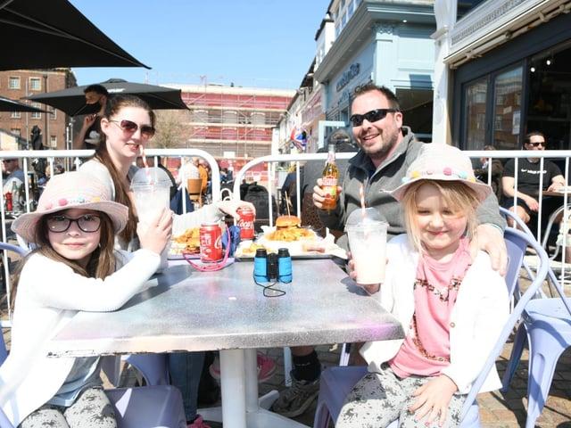 Sun hats on and milkshakes in hand