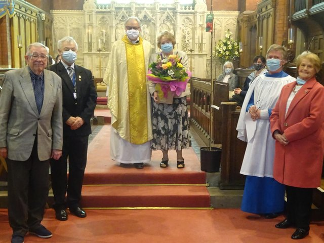 Fr David Lyon and his wife Brenda with parish officials and parishioners after his final service at St Annes Parish Church