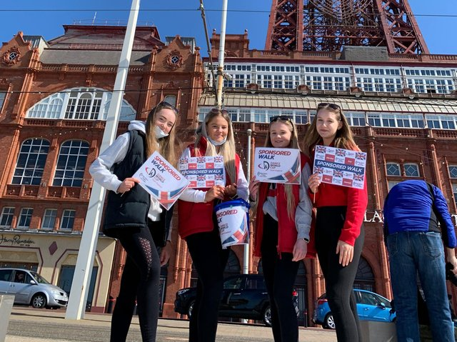 Emily Richards, 15, Ella-Rae Bailey, 14, Hannah Boden, 14, and Isobel Farey, 14, walked 45 km from Barbara Jacksons Theatre Arts Centre in Fleetwood to Blackpool Pleasure Beach - and back to raise funds for the Dance World Cup competition