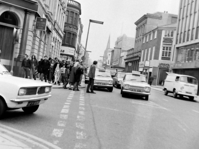 A typical afternoon in Preston town centre showing traffic on the roads