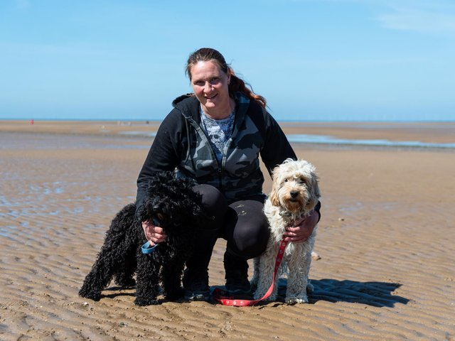 Anne Brookes with her two dogs Rockruss (black) and Lilypup (white) on Fleetwood beach. Anne was rescued by the RNLI whilst out walking with her dogs after the tide caught up to her. Photo: Kelvin Stuttard