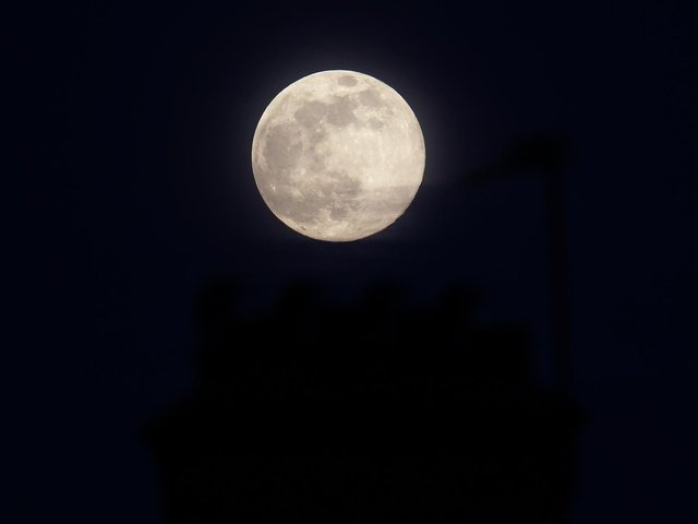April's supermoon will appear 14 per cent larger and 30 per cent brighter than some previous full moons. (Getty Images)