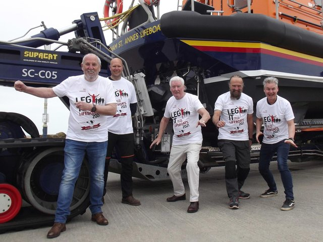 Roy and Phil Walker with RNLI representatives at the St Annes boathouse