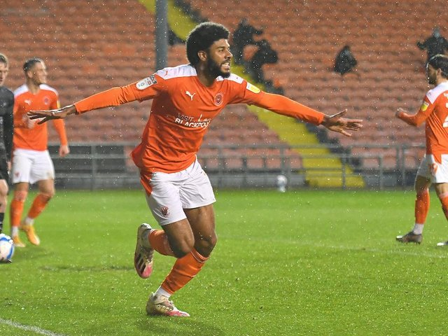 Ellis Simms scored both goals as Blackpool beat Doncaster to guarantee their place in the play-offs