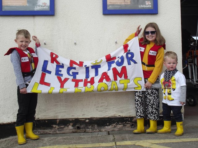 Thomas (age five) and Evie Booth (nine) with their cousin Freddie Bridge (22 months), son of crew member Will Bridge, showing their support for their fund raising at  start of Lytham St Annes RNLI's Leg It for the Lifeboats fund-raiser 2021