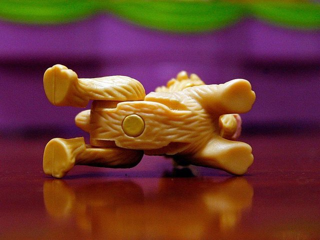 A 1/8-inch magnet is shown attached to the underside of a dog from the Polly Pocket toy series